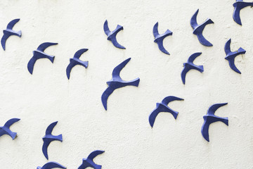 Birds on a wooden wall