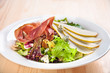 Fresh green salad with pears and jamon
