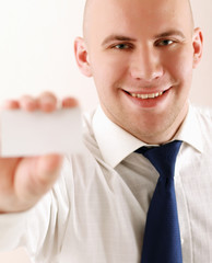 young  business man holding blank white business card