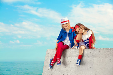 Fashion kids resting on the sea