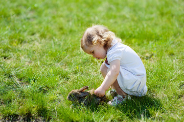 child with a rabbit on the grass