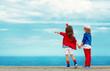 Fashion kids points to the sea