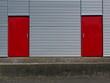 canvas print picture - Wellblechfassade mit roten Türen am Segelflugplatz Oerlinghausen