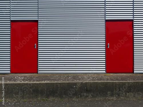 canvas print picture Wellblechfassade mit roten Türen am Segelflugplatz Oerlinghausen