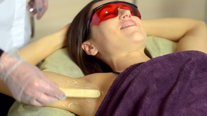 Laser hair removal for a young woman. armpit without hair. close