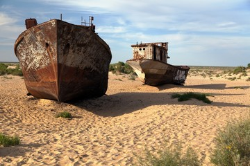Boats in desert around Moynaq - Aral sea - Uzbekistan