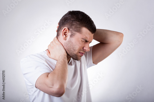 Man suffering from neck pain