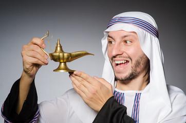 Arab with lamp in studio