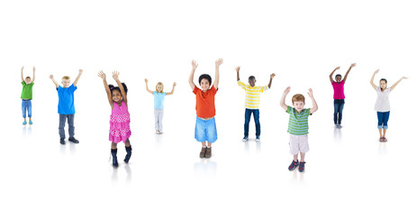 Multi-Ethnic Children with Their Arms Raised