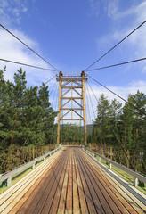 Suspension bridge between the islands on mountain river Katun.