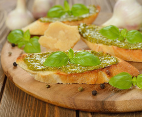 Bruschetta with pesto and basil