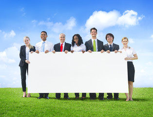 Cheerful Business People Holding Empty Billboard Outdoors