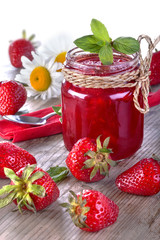 .Fresh and healthy homemade strawberry jam on the table