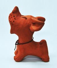 Clay dog barking