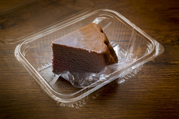 Chocolate cheesecake on plastic box