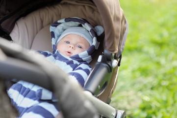 Little baby boy in stroller