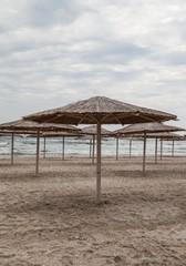 Sun umbrellas on empty beach