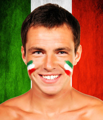 Portrait of an italian soccer fan over italy flag background