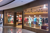 Boutique display window with mannequins in fashionable dresses - 65133311