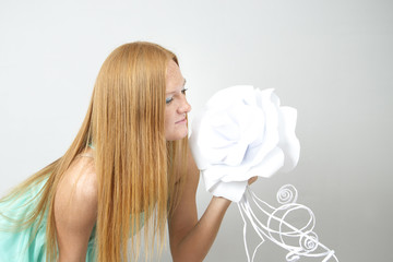 Portrait of red-haired woman with paper flower