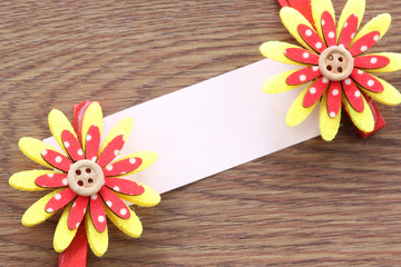 Red and yellow of artificial flowers and note paper stuck on dar