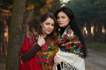 Russian village girls in headscarves in a dense forest