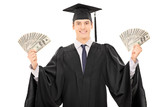 Male graduate student holding money