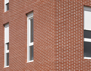 Building facade with red bricks and windows