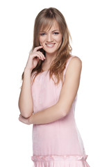Feminine teen girl  in pink dress smiling