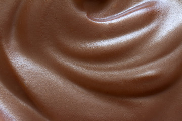 Chocolate cream closeup background texture