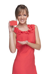 Beautiful smiling female showing red card in hand