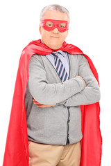 Senior man in superhero costume posing