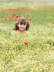 happy little girl on spring meadow