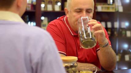 mature man drinking tea in the cafe.