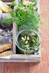 Delicious homemade pesto in glass.Selective focus