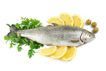 Fresh trout with parsley, lemon and olives isolated on white
