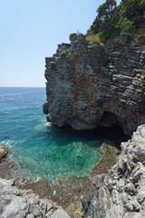 Panoramic view of the small cove and grotto in rocks.