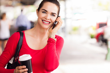 Woman drinking coffee and talking on phone