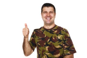 smile soldier in camouflage uniform showing ok sign