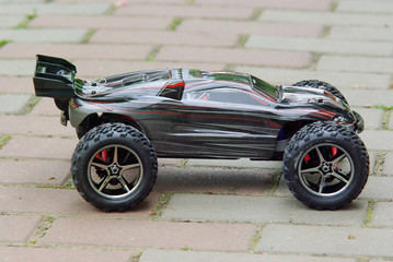 Radio controlled sport car on the pavement.