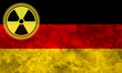 Grunge flag background with nuclear sign - Germany