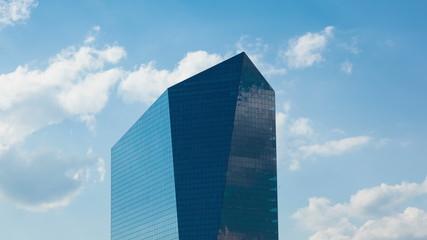 Timelapse of the philadelphia skyscraper over a cloudy blue sky