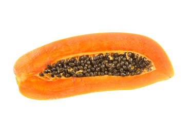 Half of fresh papaya fruit with seed isolated on white