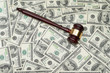 gavel on dollar background
