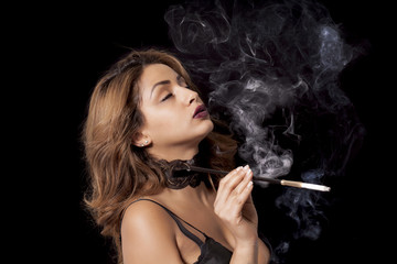 Sexy woman with cigarette holder smoking