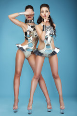 Extravagance. Two Heeled Women in Futuristic Clubwear. Hangouts