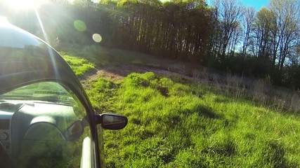 Driving a car through the countryside.