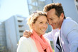 Sweet loving 40-year-old couple in urban area