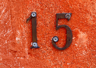 number fifteen formed from two digits one and five on the wall