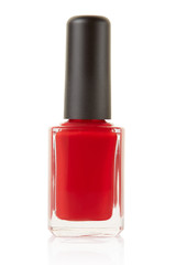 Red nail polish bottle on white, clipping path